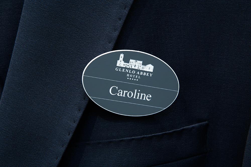 Matte finish and brushed aluminium laser-engraved hospitality badges.
